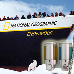 people standing on bow of boat looking at polar bear national geographic endeavour dispensers in foreground dispenser amenities