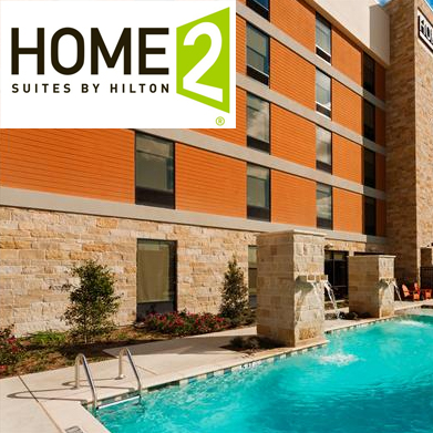 home2 suites by hilton frisco as seen from outside by pool dispenser amenities