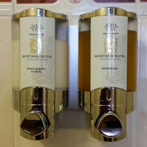 montana hotel custom hand and body lotion and hand wash dispensers mounted on white wall dispenser amenities