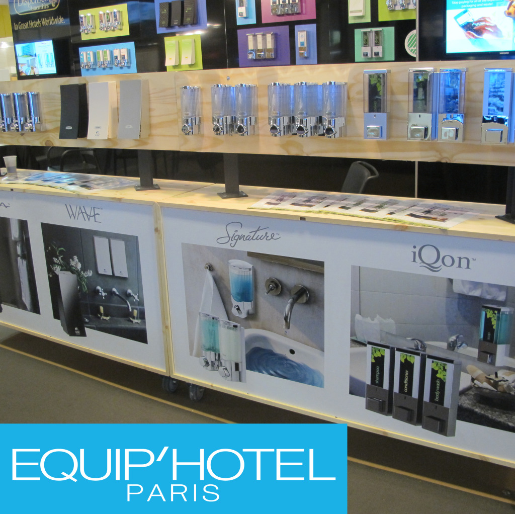 wall full of dispensers on display wave signature iqon equip'hotel paris trade show dispenser amenities