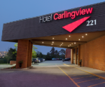 hotel carlingview front entrance at dusk dispenser amenities