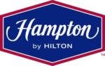 Hampton by Hilton logo red white and blue on white background dispenser amenities