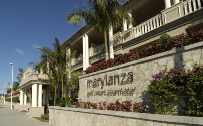 hotel with many columns and palm trees marylanza golf resort hotel dispenser amenities